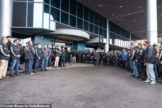 A huge crowd gathered to greet the two cops as they left hospital on Thanksgiving