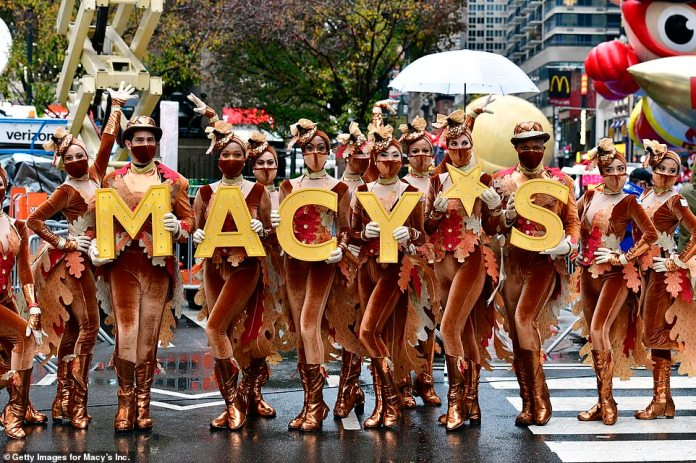 Performers prepare at the 94th Annual Macy's Thanksgiving Day Parade despite the rainy weather