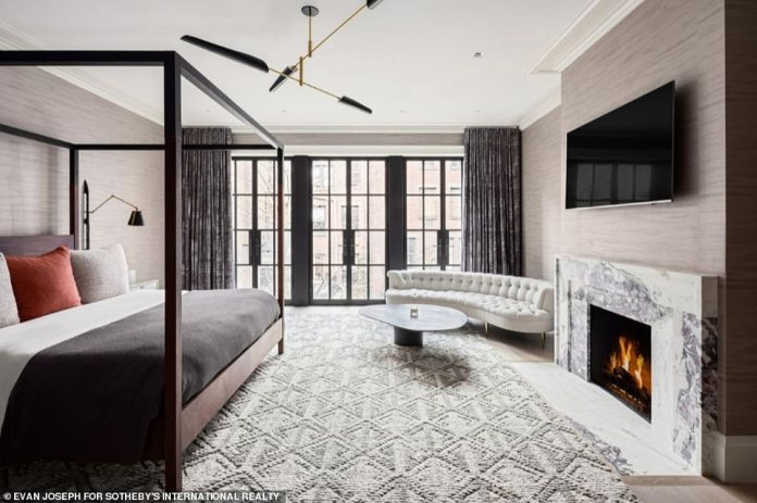 The main bedroom is set across the entirety of the fourth floor, and is complete with a marble fireplace and floor-to-ceiling windows
