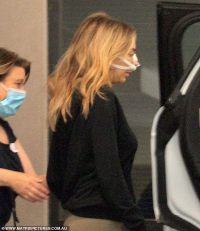Nadia Bartel wears a bandage across her nose leaving a private hospital