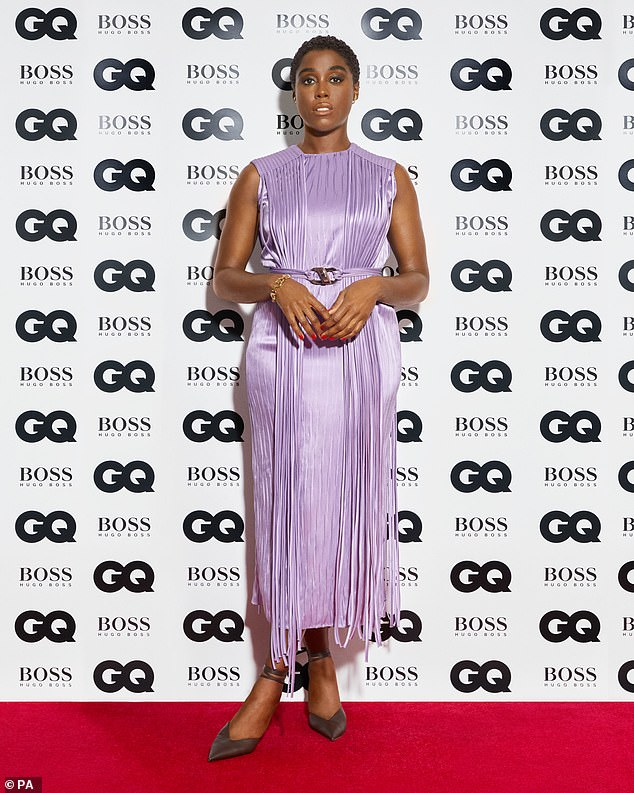 Stunning: Leshana posed in a stunning lilac gown for the virtual ceremony