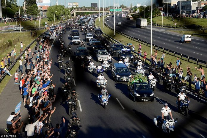 The hearse carrying the casket of soccer legend Diego Maradona drives to the cemetery in Buenos Aires, Argentina