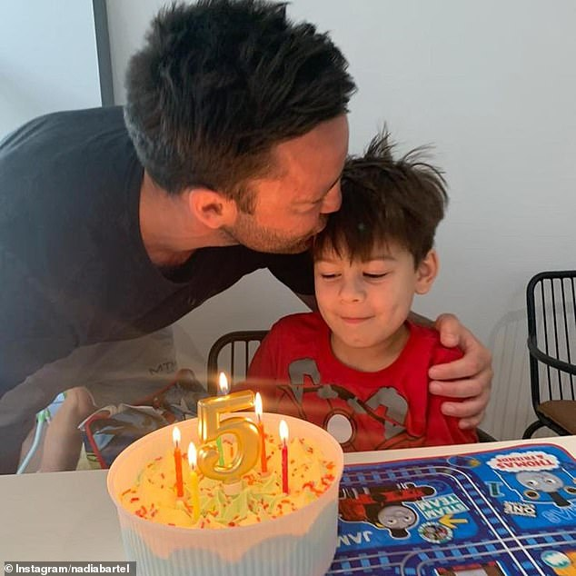 'Proud to be your dad': Jimmy, 36, looked every inch the doting father as he praised his 'caring' and 'sensitive' son