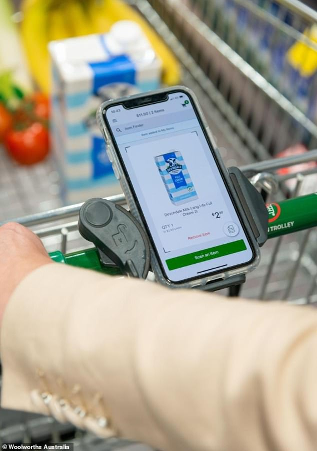 Customers have discovered shopping trolleys fitted with mobile phone holders (pictured) to make grocery trips easier