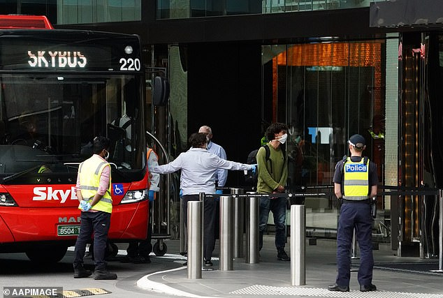 Recently arrived overseas travellers arrive at the Crown Promenade Hotel in Melbourne in March