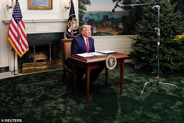 The president on Thursday spoke to reporters from a small desk in the Diplomatic Reception Room after holding a teleconference with US military leaders