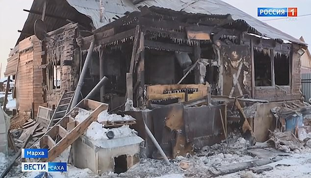 She woke her sleeping children after being alerted to the fire by her 14-year-old son and broke a window to escape when she realised they were trapped in the house (pictured after the fire)