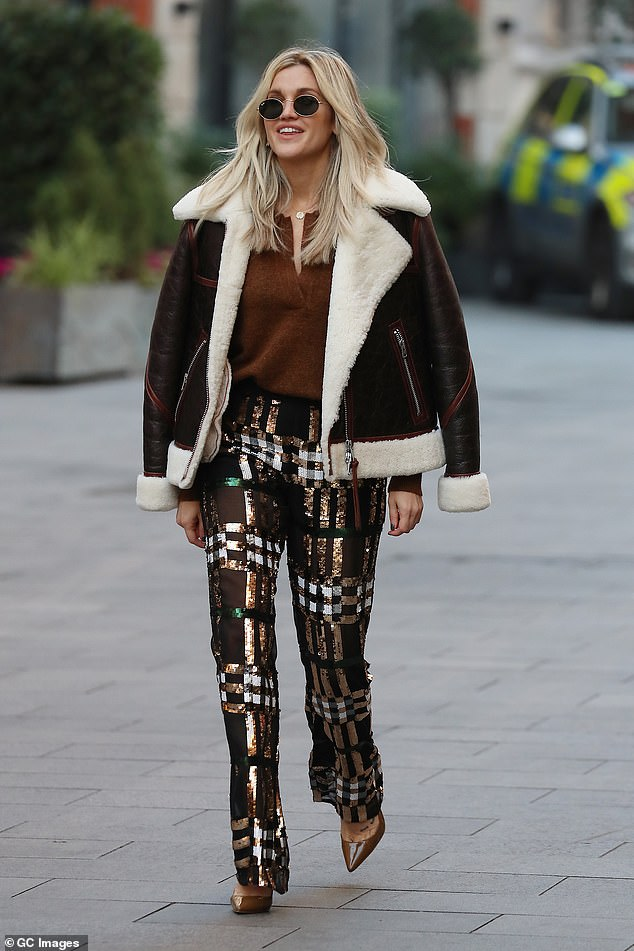 Smiles: Ashley Roberts appeared in joyful spirits as she left Global Studios after her appearance on the Heart FM's Breakfast Show in central London on Friday