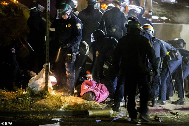 A CHP officer arrests an activist during the demonstration last night in El Sereno, Los Angeles