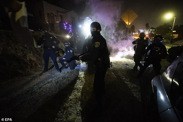 CHP officers clear activists attempting to reclaim Caltrans homes in El Sereno, Los Angeles last night