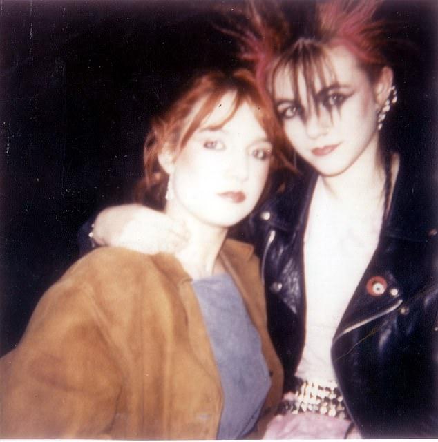 Punk shocker: Elizabeth Hurley (R) aged 18 with sister Kate in 1983