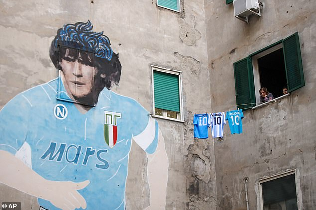 Murals across the city have becomemakeshift shrines, with fans gathering to mourn their hero