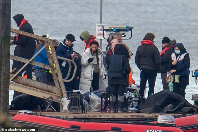 Take a break: Michelle and the rest of the crew were spotted tucking into some refreshments as production set up another shot on the wooden jetty