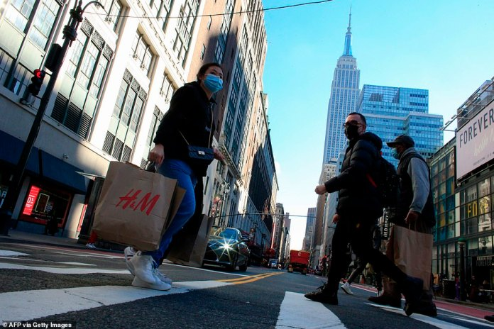 Costumers carry shopping bags in New York on Black Friday, November 27, 2020