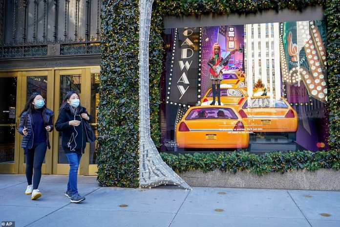 Two women leave Saks Fifth Avenue on Friday morning. The department store saw nowhere near as many in-store shoppers