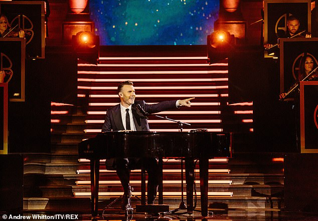 Beau: Gary looks dapper in a three-piece suit and later takes to the piano to duet with Ronan, 43