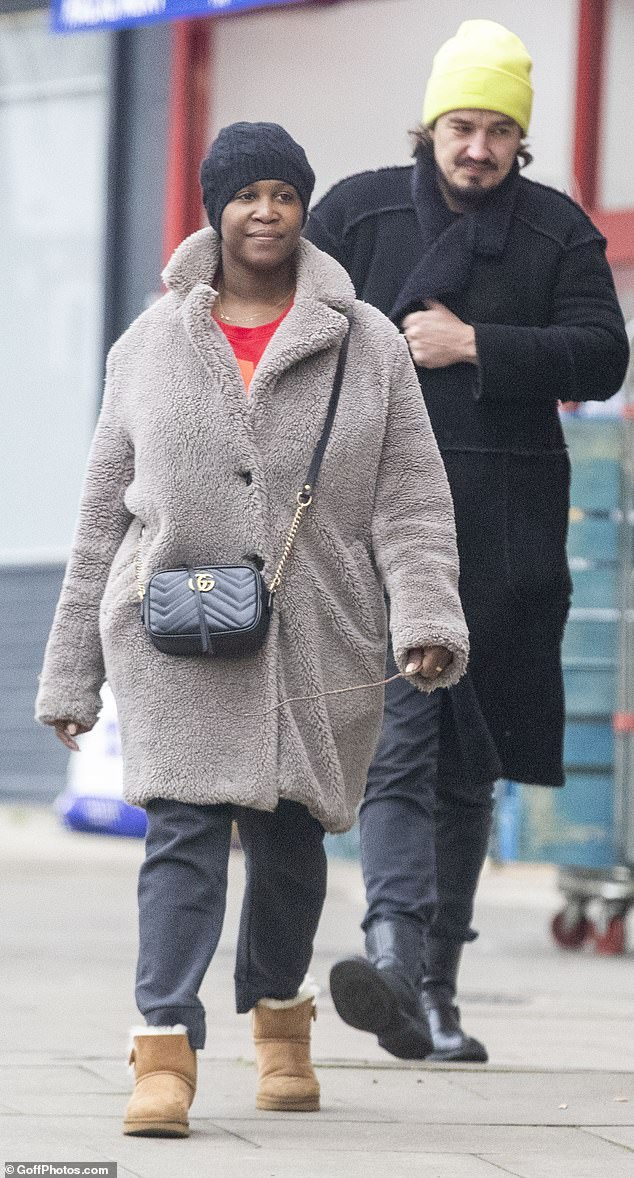 Cosy:The former professional dancer, 39, wrapped up for the cold weather in a cosy grey teddy jacket and a pair of slouchy sweatpants, which she tucked into a pair of chestnut coloured Ugg boots
