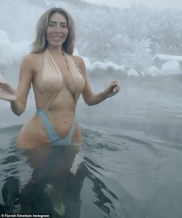 Holiday spirit:The 5ft7in reality star splashed around in the water and danced for her viewers to the strains of Michael Bublé's version of White Christmas