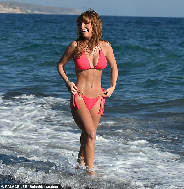 Summer Monteys-Fullam showcases her incredible bikini body in a hot pink two-piece