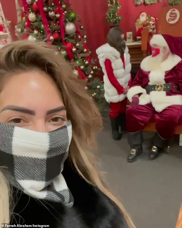 Business trip:Her daughter also got a chance to meet Santa at the tourist attraction, though she admitted earlier in the video that 'Santa isn't real.'