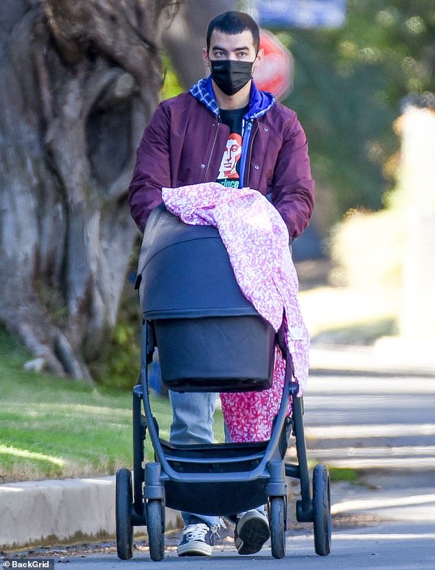 Joe Jonas spends some quality time with his baby daughter Willa as he takes her for a walk in LA