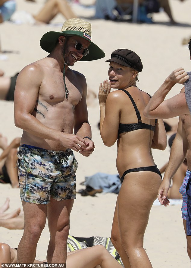 Home and Away star Luke Jacobz hits the beach with female pals after postponing wedding due to COVID