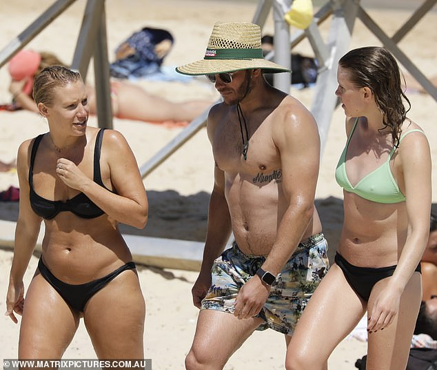 Fun in the sun!Despite being tragically forced to postpone his wedding to his American fiancée Stuart days earlier, Luke managed to crack a smile as he socialised with his pals