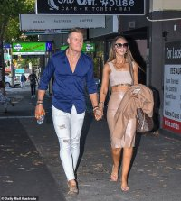 Elizabeth Sobinoff shows off her stomach tattoo as she steps out with Seb Guilhaus for a date night