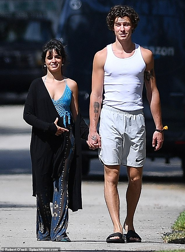 Taking pause: Shawn said that spending time around Cabello and learning how she deals with media scrutiny of her body has 'really changed my view of mine,' acknowledging that she faces a level of inspection as a female that is ten time worse than his; pictured March 2020
