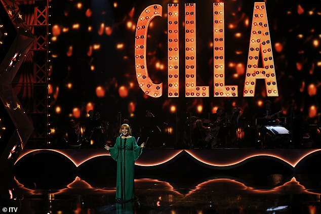 Green dress: Sheridan wore a beautiful moss green dress with draped sleeves in her performance