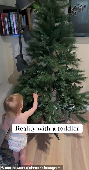 His daughter Marlie Mae was filmed playing with the branches of their empty tree