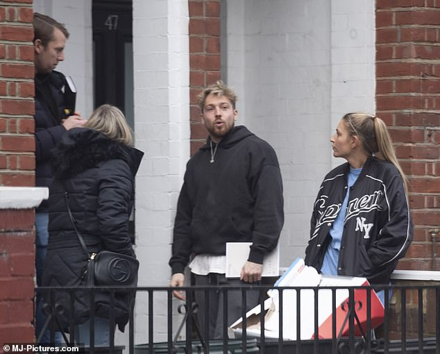 Easy breezy:Sam looked equally casual, dressed in slate grey joggers and white T-shirt with a black hoodie finished off his ensemble