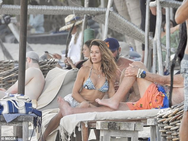 Just the two of us: The 49-year-old actress showcased her slim waist as she perched on a chair overlooking the beach in trendy Tulum