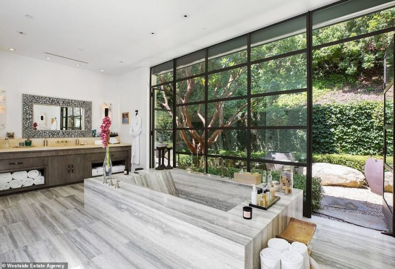 A nice place to soak: The bathtub almost looks unreal as it is a large rectangle made with the same material as the floor