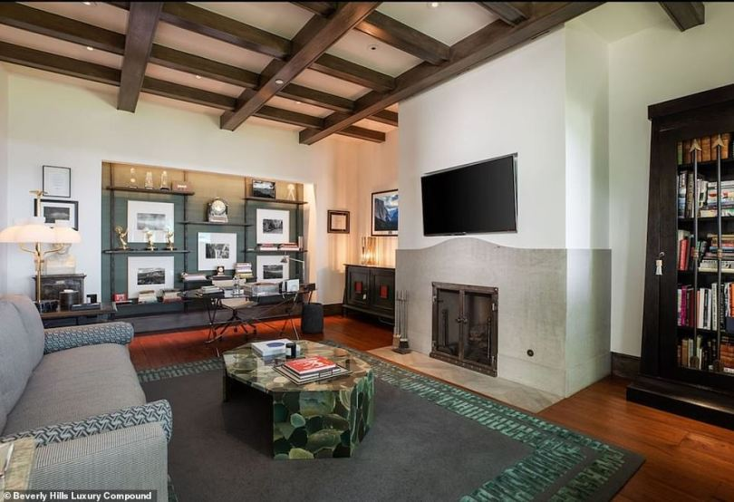 A place where Ryan kept his awards: This office has Emmys on a shelf and a living room with a fireplace