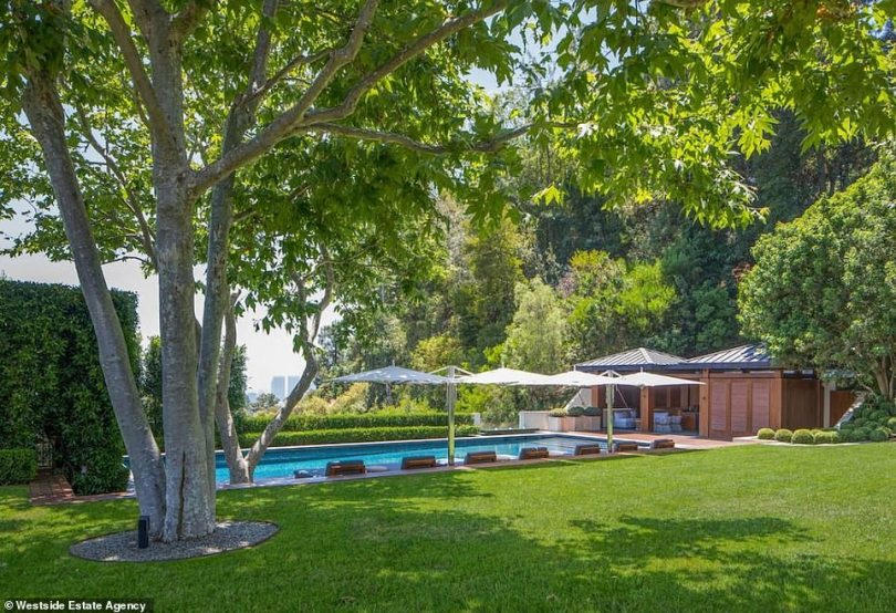 He likes to work hard:Seacrest has been called the hardest working man in showbiz thanks to juggling several projects at once; here is a look at the swimming pool with views of LA