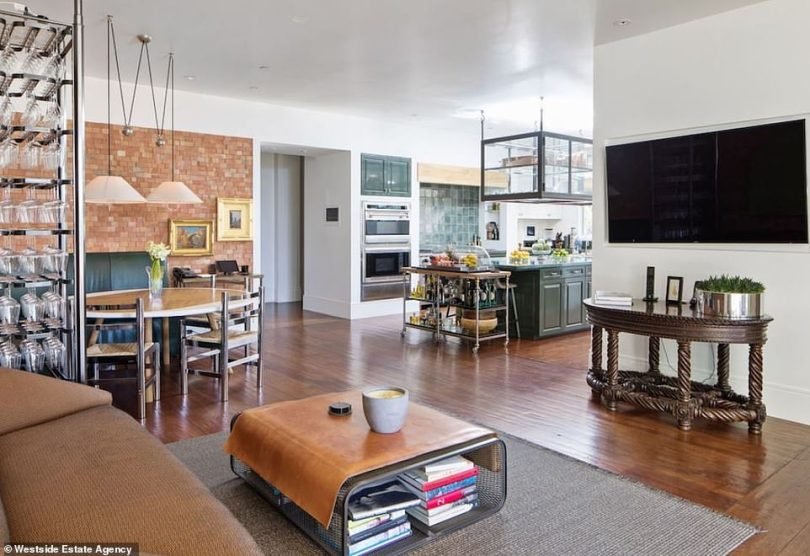 So much off to the side: There is a breakfast nook as well with a mini living room that can be seen from the kitchen