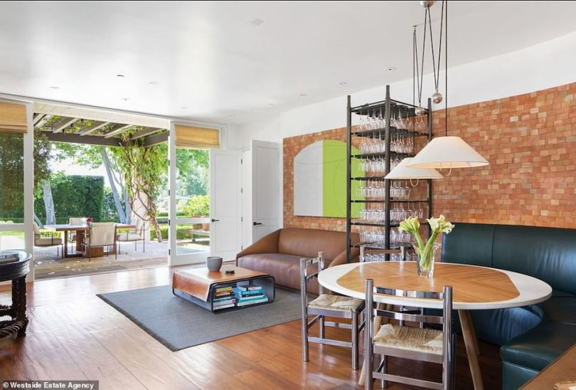 Another well appointed room: This area has a bench with tale against a brick wall and roomy for a sofa and table