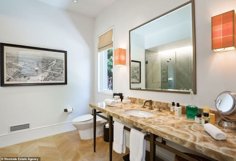 A similar look: And this extra bathroom has a stone counter top with matching colors in the tiled floors