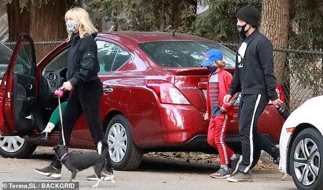 Getting out: Malin Akerman and her husband Jack Donnelly were seen taking son Sebastian to a playground in Los Angeles on Sunday