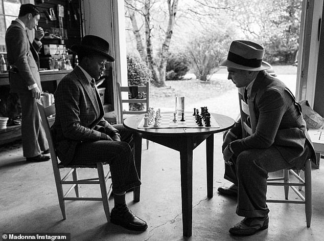 There were other beautiful photos of Rocco: including one in which he was seen engaged in a game of studious chess with his younger brother David.