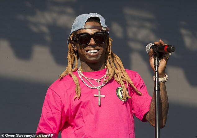 The latest:Lil Wayne, 36, says that he had planned to take the stage at Mike Tyson's fight broadcast on Triller in Los Angeles on Saturday, but it was thwarted by an 'unrelated 3rd party'