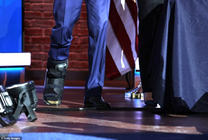Kick off on stage: Biden's surgical boot is expected to be a feature of life for several weeks, though it's unclear if he'll still be there for his inauguration