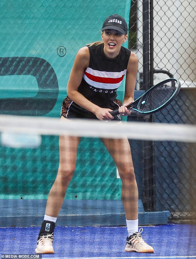 WAG Rebecca Judd works up a sweat on a Melbourne tennis court as she flaunts her toned legs in short shorts and a tank top