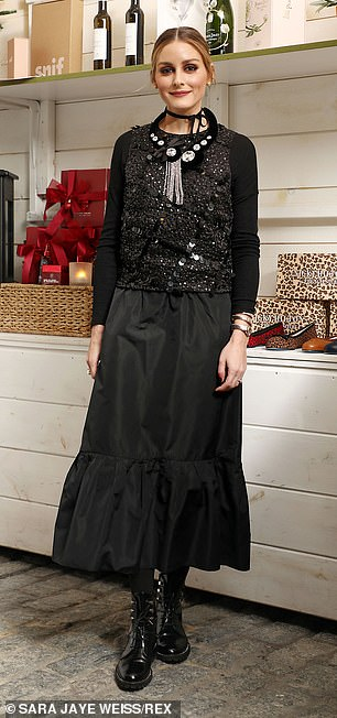 Palermo, 34, opted for a calf-length black frock with glittery bodice and ruffled hem