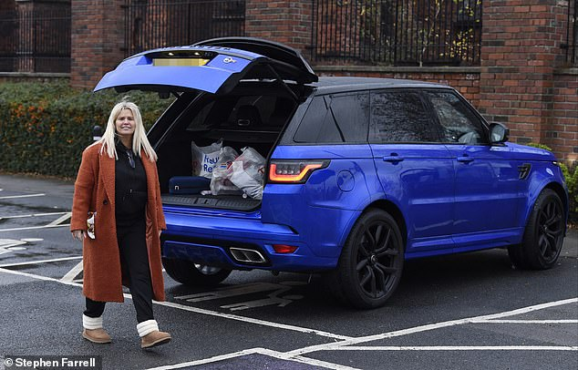 Shopping trip:Kerry appeared to only be joined by her daughter, 17, as they headed into Tesco together before later leaving with some Christmas essentials