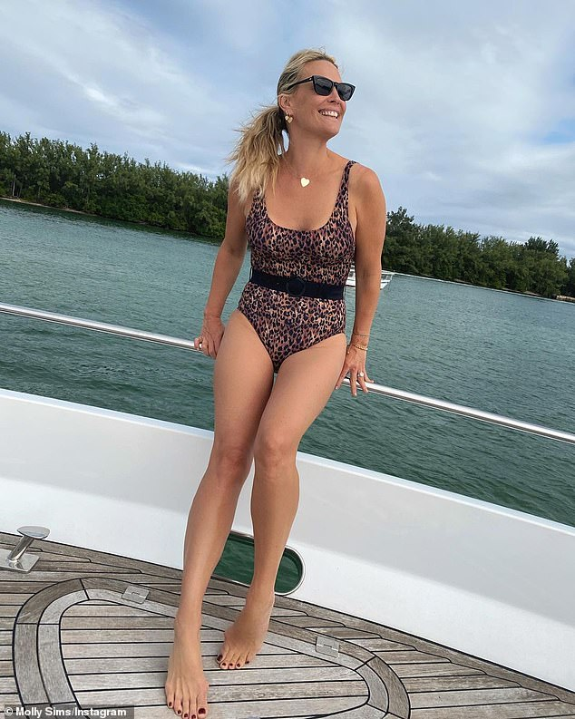 Molly Sims, 47, looks stunning in a bathing suit while enjoying a boat trip on a lake