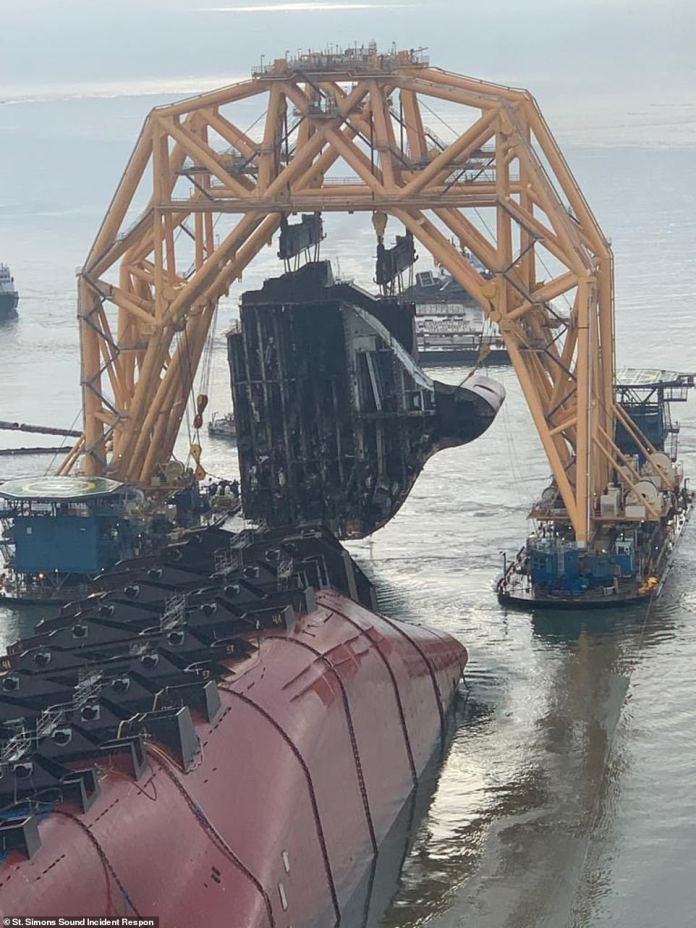 A 400-foot anchor chain is used to cut sections, exposing the many Hyundai cars trapped inside the ship