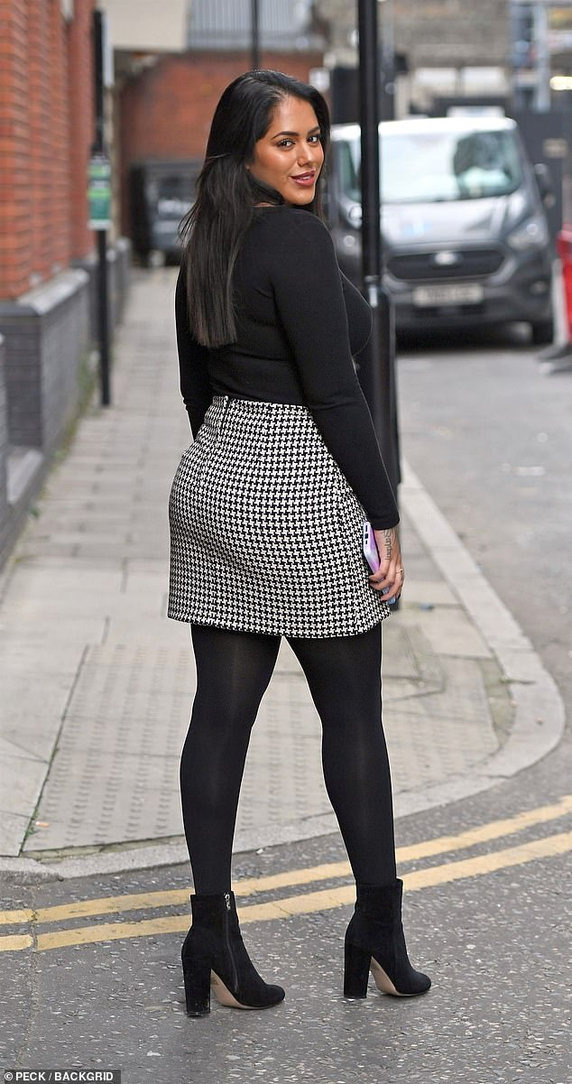 Model behaviour:Malin was full of body confidence as she posed this way and that in her monochrome ensemble