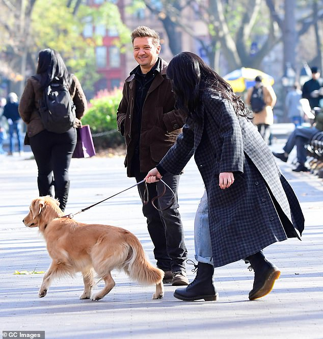 Here we go: Jeremy cut a sleek figure in a sleek brown leather jacket over a black top, while Hailee threw an oversized blue coat over a t-shirt and jeans